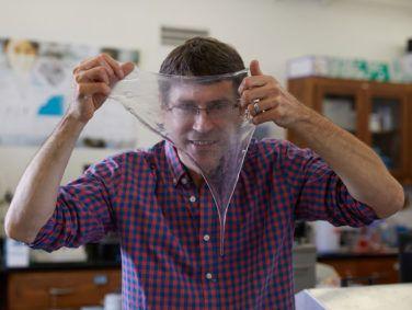 Douglas Fudge, a marine biologist at Chapman University in Orange County, hold up a sheet of hagfish slime.