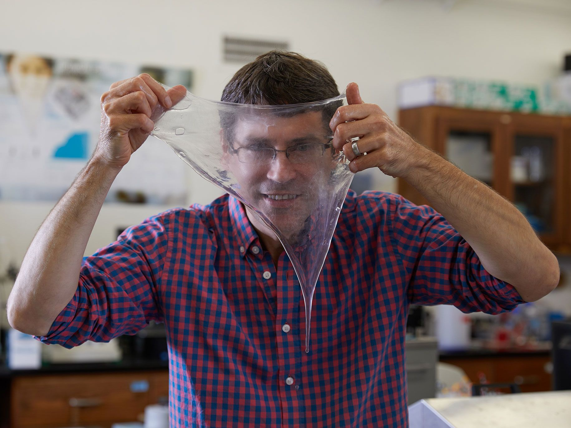 Douglas Fudge, a marine biologist at Chapman University in Orange County, hold up a sheet of hagfish slime.