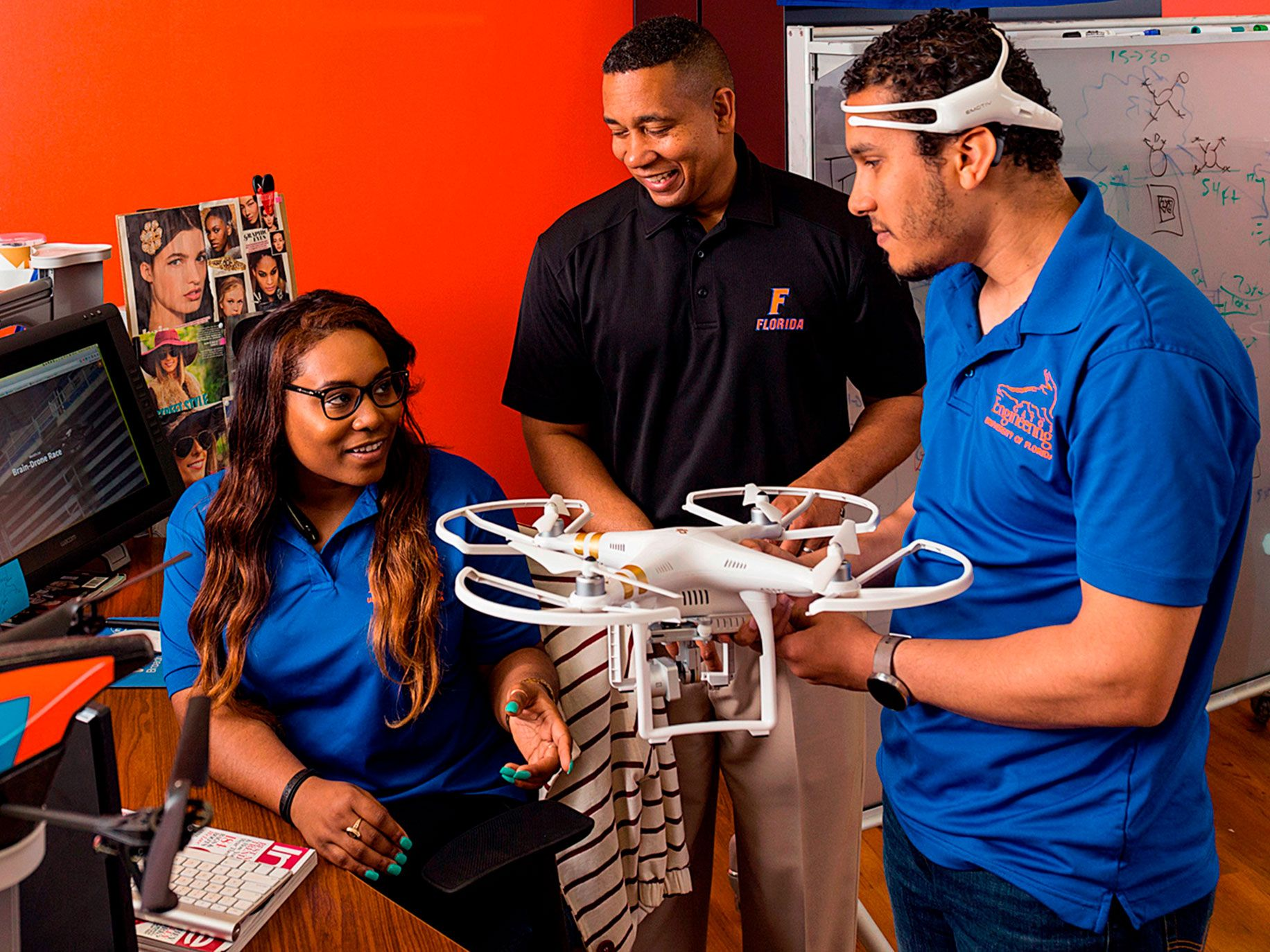 University of Florida professor Juan Gilbert (center) working with students and their brain-controlled drone.