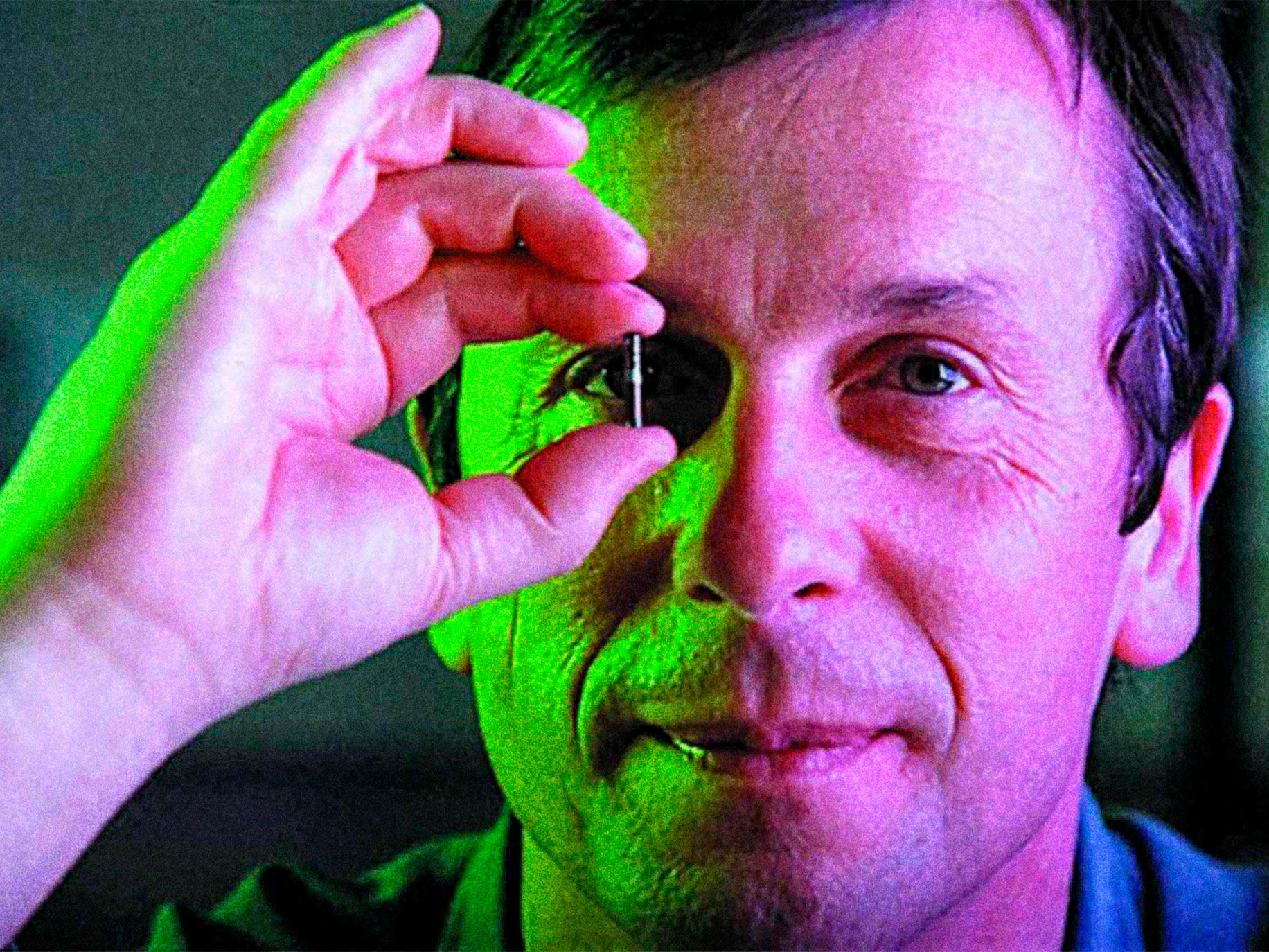 Kevin Warwick, a British engineer at Coventry University, holds a small transponder that can be implanted in a human. Warwick has a similar chip in his arm that allows him to control appliances in his office.