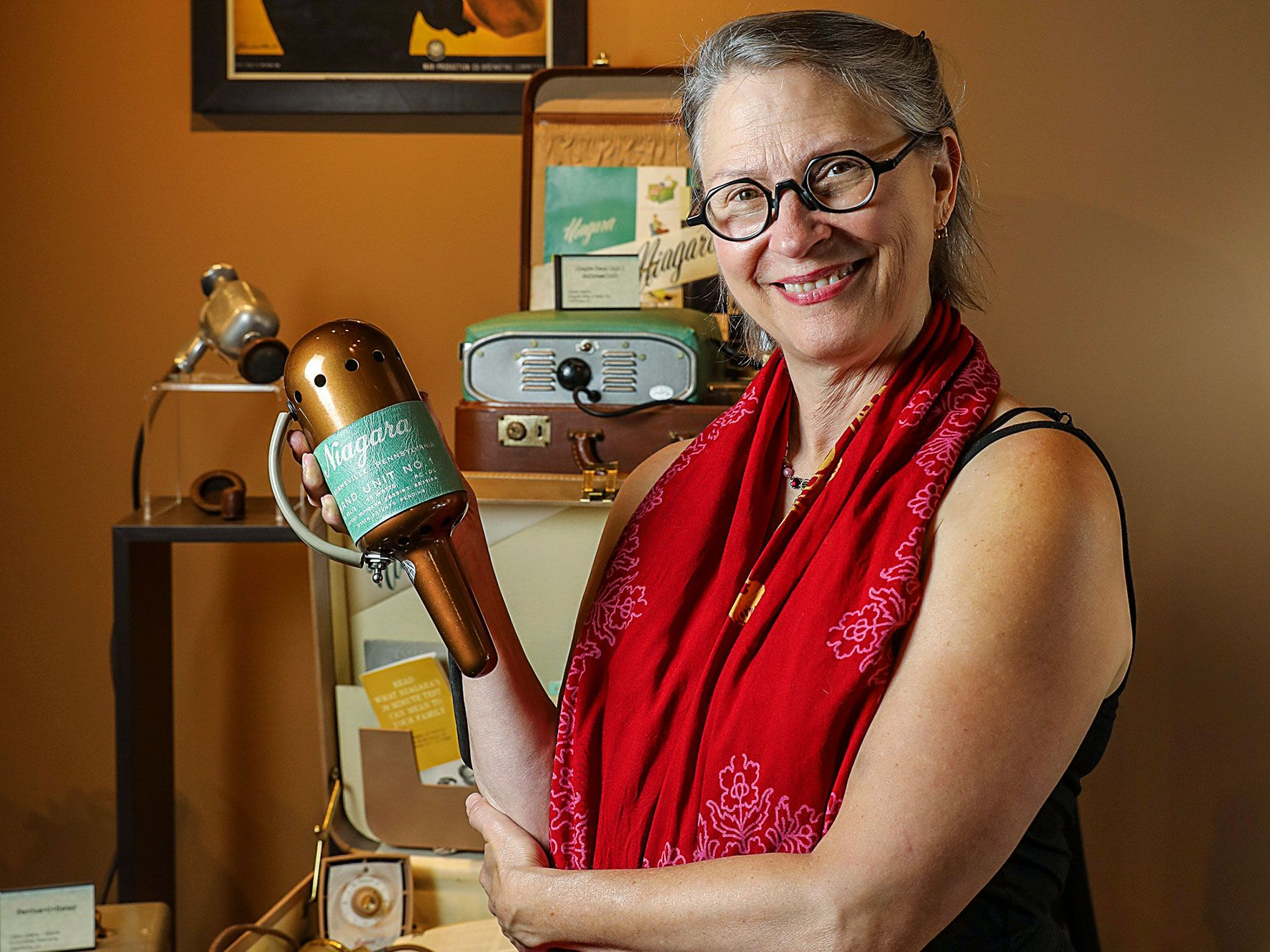 Carol Queen, the staff sexologist at Good Vibrations, holds a 1940s-era Niagara vibrator, part of the store's extensive collection of antique sex toys.