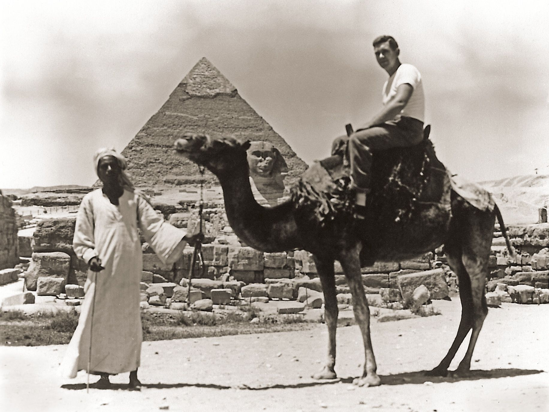 Veterinarian Fred Pulling riding a camel in Giza, Egypt, during the Hearst Arabians expedition.