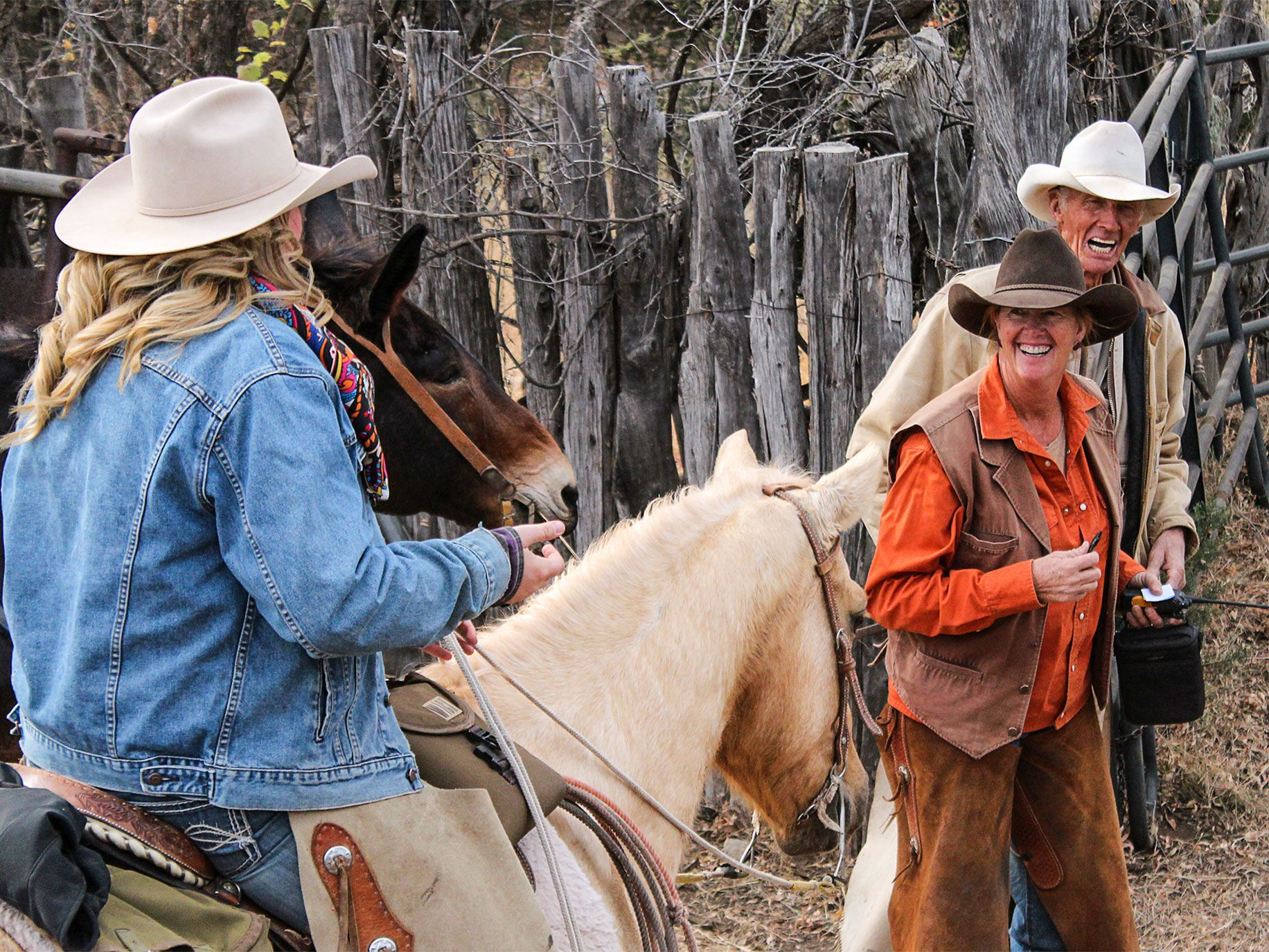 Kelly Kimbro (center) laughs with her daughter, Mackenzie (on horseback), and her father, Warner Glenn. Kimbro owns and leases land that abuts about 150 acres of the Roosevelt Reservation in Arizona, where there is border fencing.