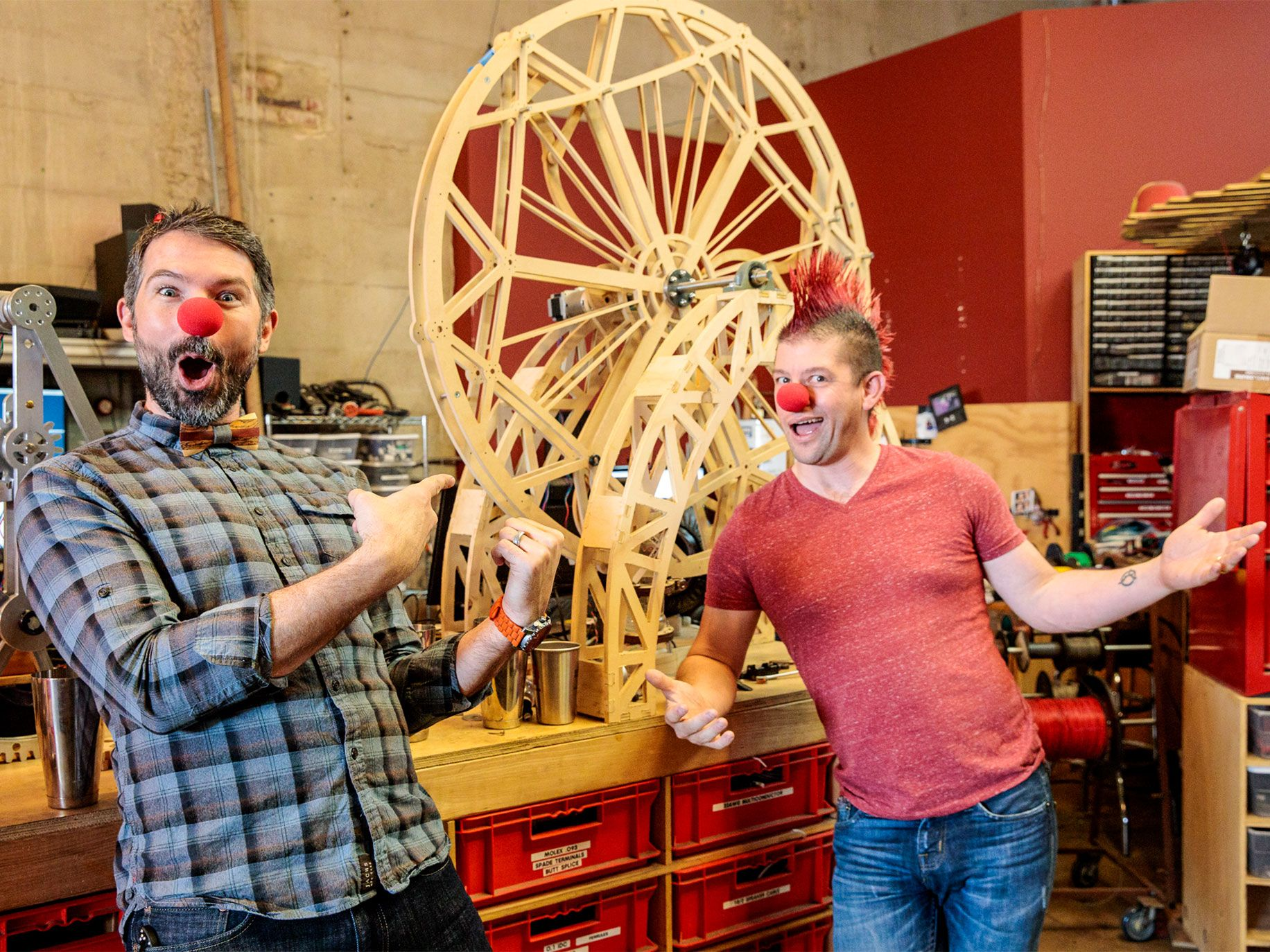 Co-founders Brent Bushnell and Eric Gradman clown around with prototypes in Two Bit Circus' company workshop in Los Angeles.