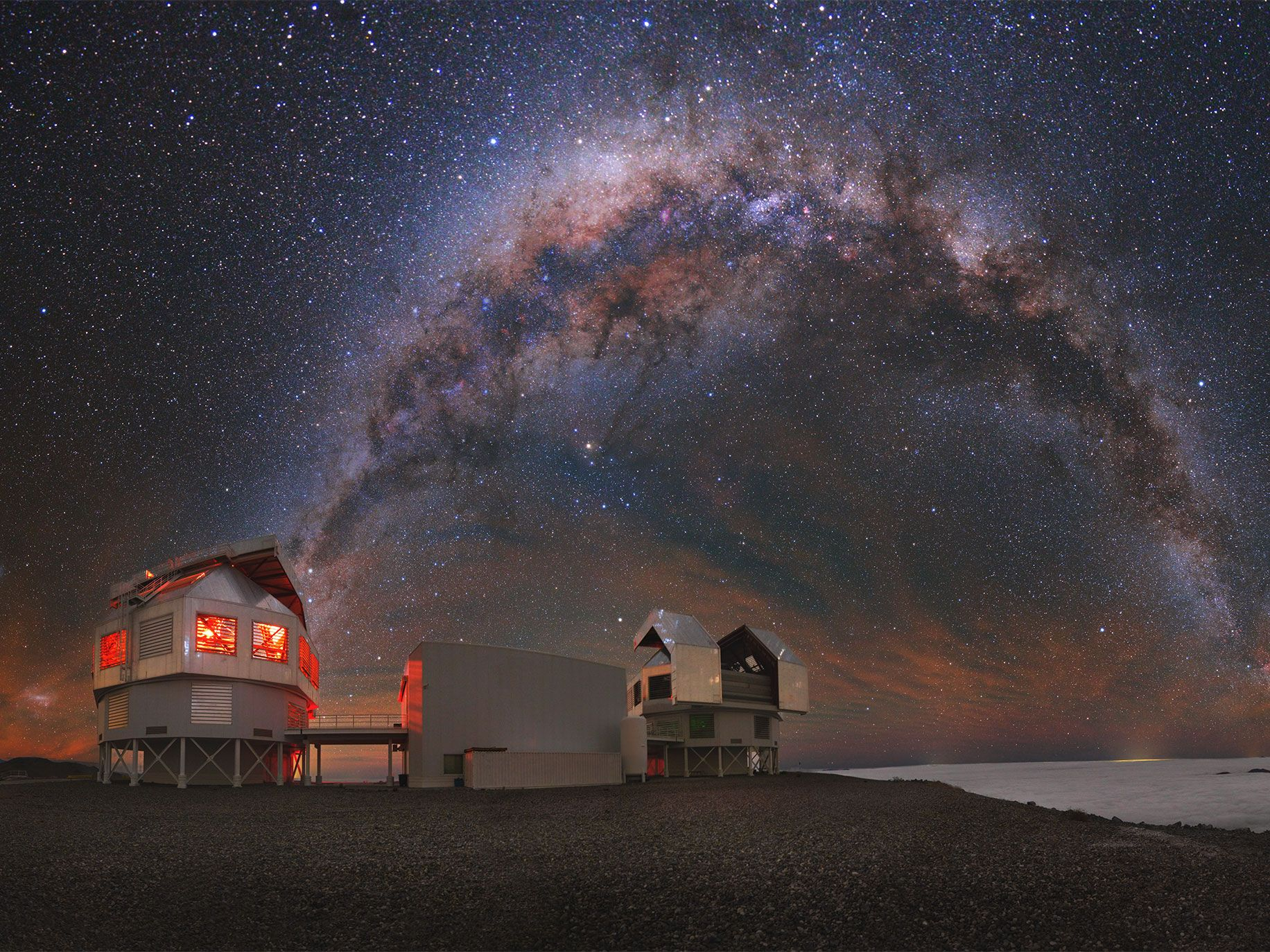 The Milky Way shines over the Las Campanas observatory in Chile, one of the facilities that helped to confirm the existence of gravitational waves last summer. The orange cloudlike effect in the sky comes from an especially bright atmospheric afterglow.