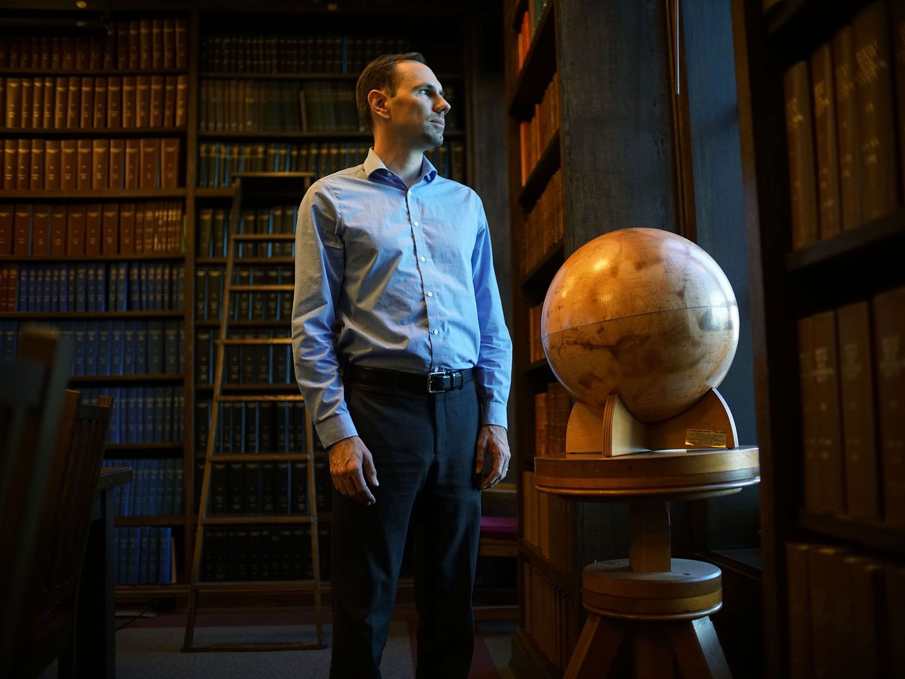 Tony Piro stands in the library at the Carnegie Institute in Pasadena.