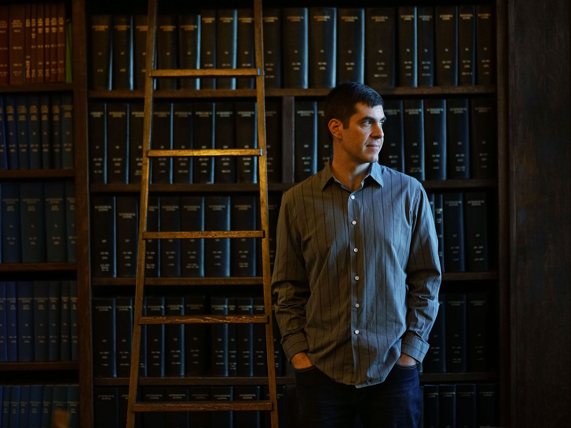 Josh Simon stands in the library at the Carnegie Institute in Pasadena.