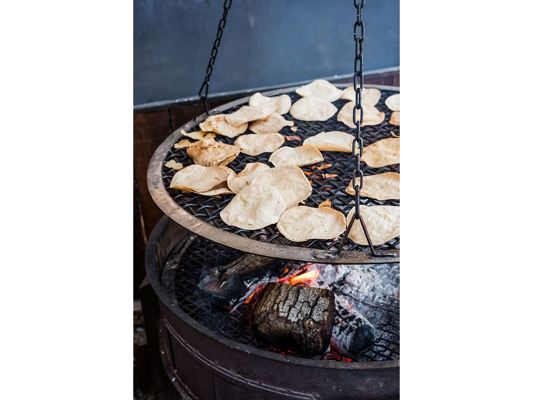 Tortillas rotate on a grill at Deckman's.
