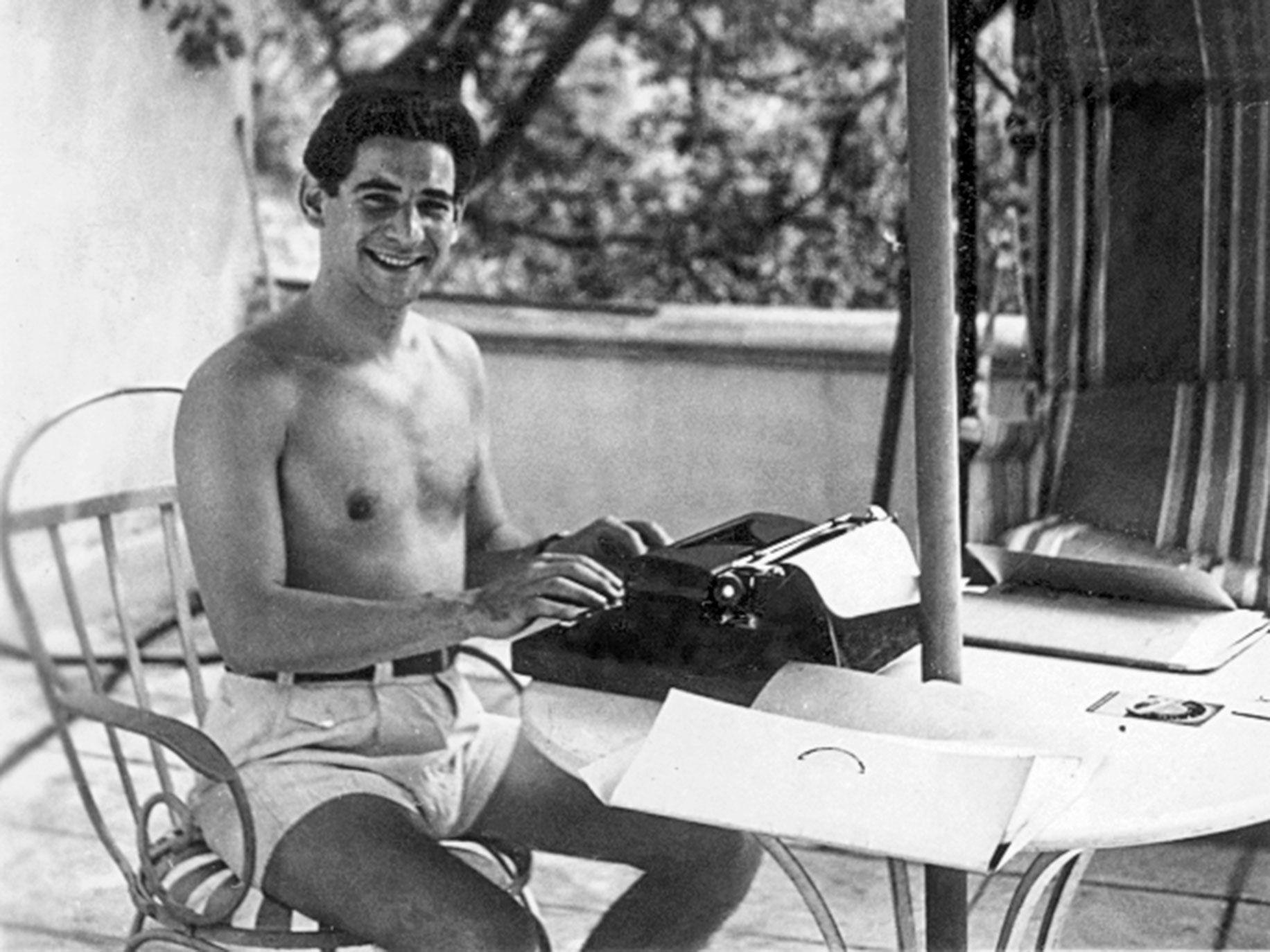 Leonard Bernstein in Hollywood, 1944, with portable typewriter.