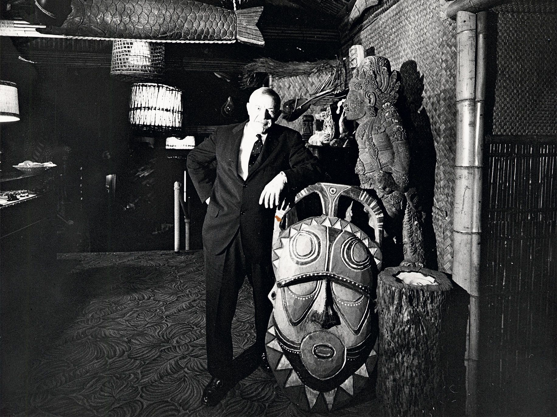 Trader Vic's founder and namesake, Victor Bergeron, with tiki masks in his famed San Francisco restaurant in 1961.