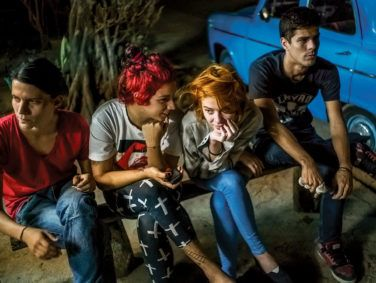 "A group of Cuban kids wait for $1 pizzas in Havana in a photograph from Michael Christopher Brown's ""Paradiso"" series at the Annenberg Space for Photography."