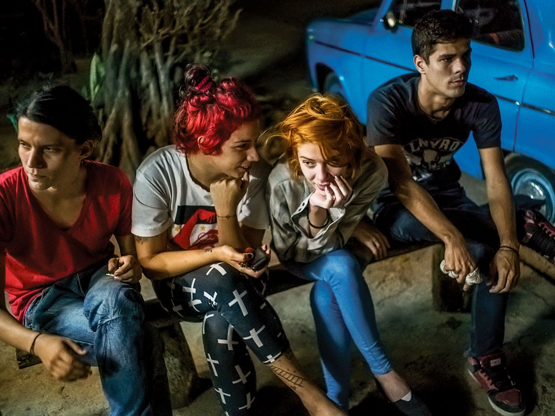 """A group of Cuban kids wait for $1 pizzas in Havana in a photograph from Michael Christopher Brown's """"Paradiso"""" series at the Annenberg Space for Photography."""