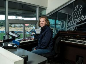 Los Angeles Dodgers' organ player, Dieter Ruehle, in the box above home plate at Dodger Stadium.