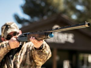 Learning to hunt, Jason G. Goldman points a semi-automatic shotgun during firearms training. He found hunting for food to be more exciting and fulfilling than he had expected.