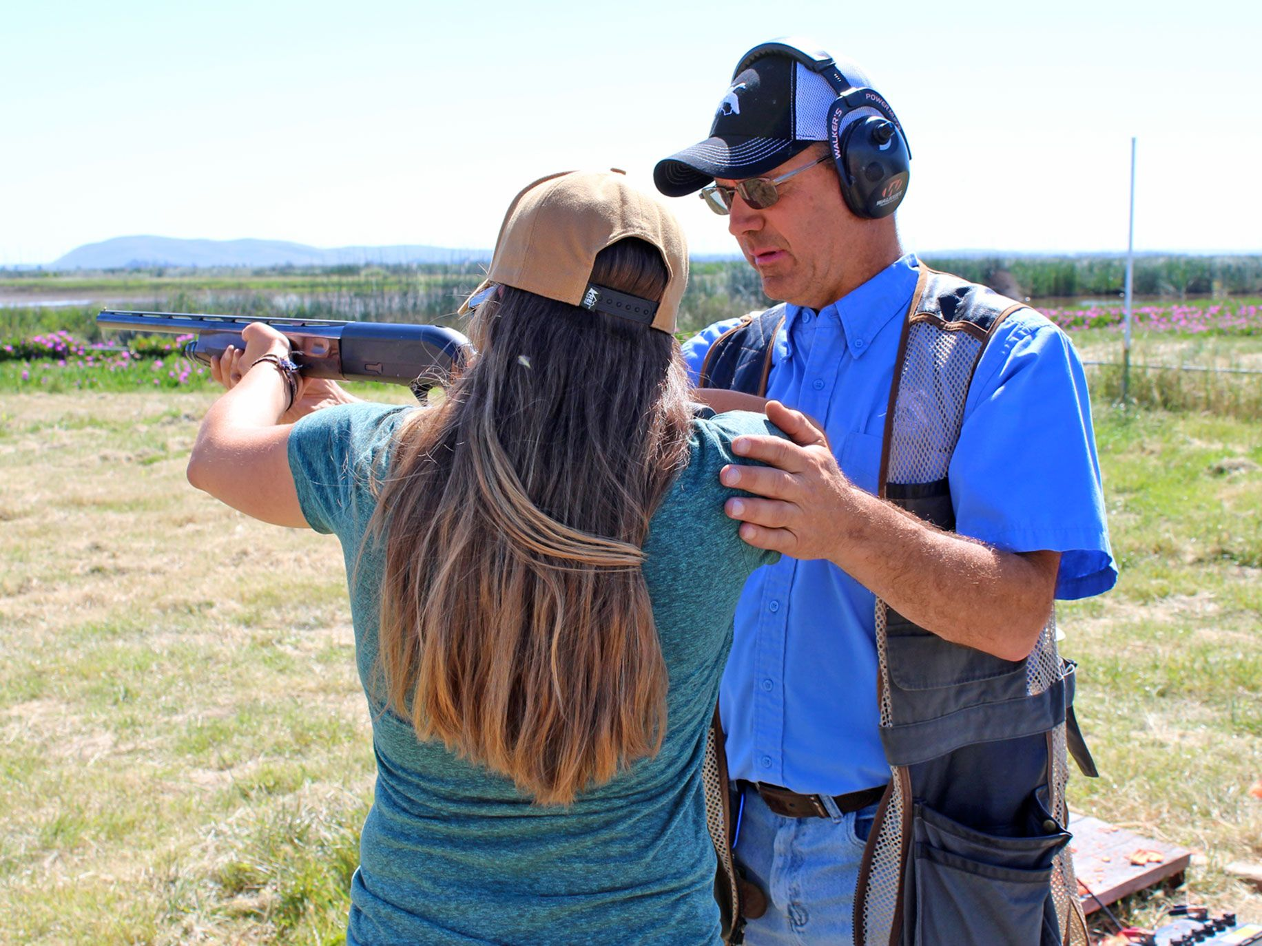 A student and instructor at the Hunting 101 for Adults class at Grizzly Ranch in the Suisun Marsh, where students received shooting instruction and learned about wild game processing and preparation.