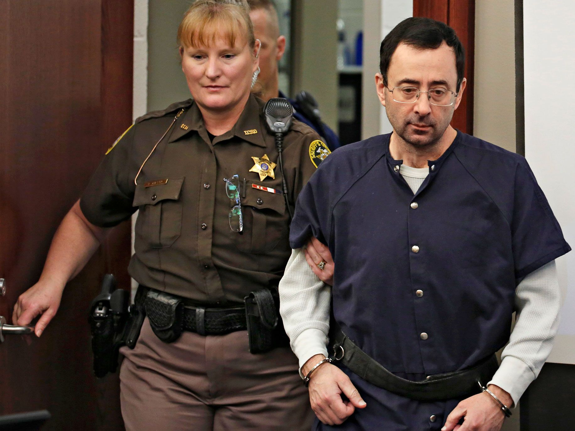 Former Michigan State University and USA Gymnastics doctor Larry Nassar arrives for a sentencing hearing in Lansing, Mich., in January. More than 300 former gymnasts, many of them represented by John Manly, have accused Nassar of a pattern of abuse dating back two decades.