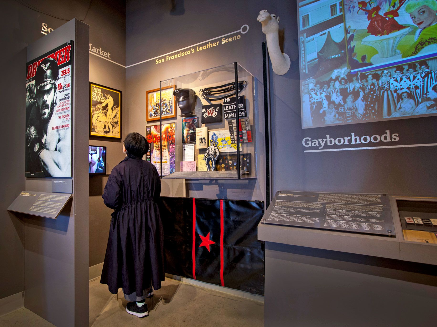 A visitor looks at an exhibit at the GLBT History Museum in San Francisco.