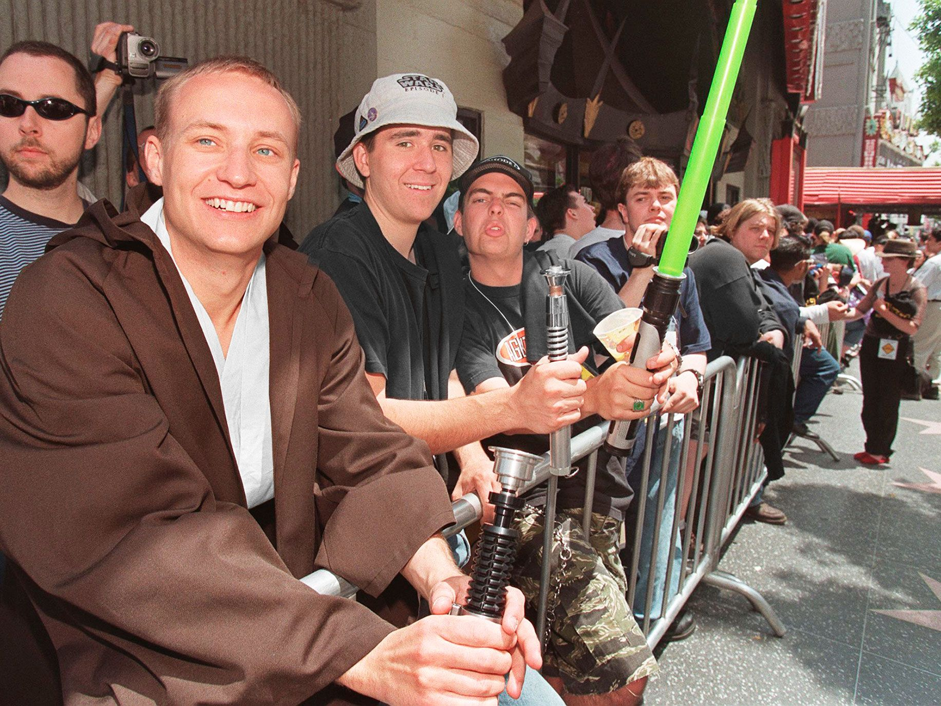 "Star Wars fans with their light sabers as they wait in line for tickets to go on sale for 1999's ""Star Wars: Episode 1 — The Phantom Menace."""