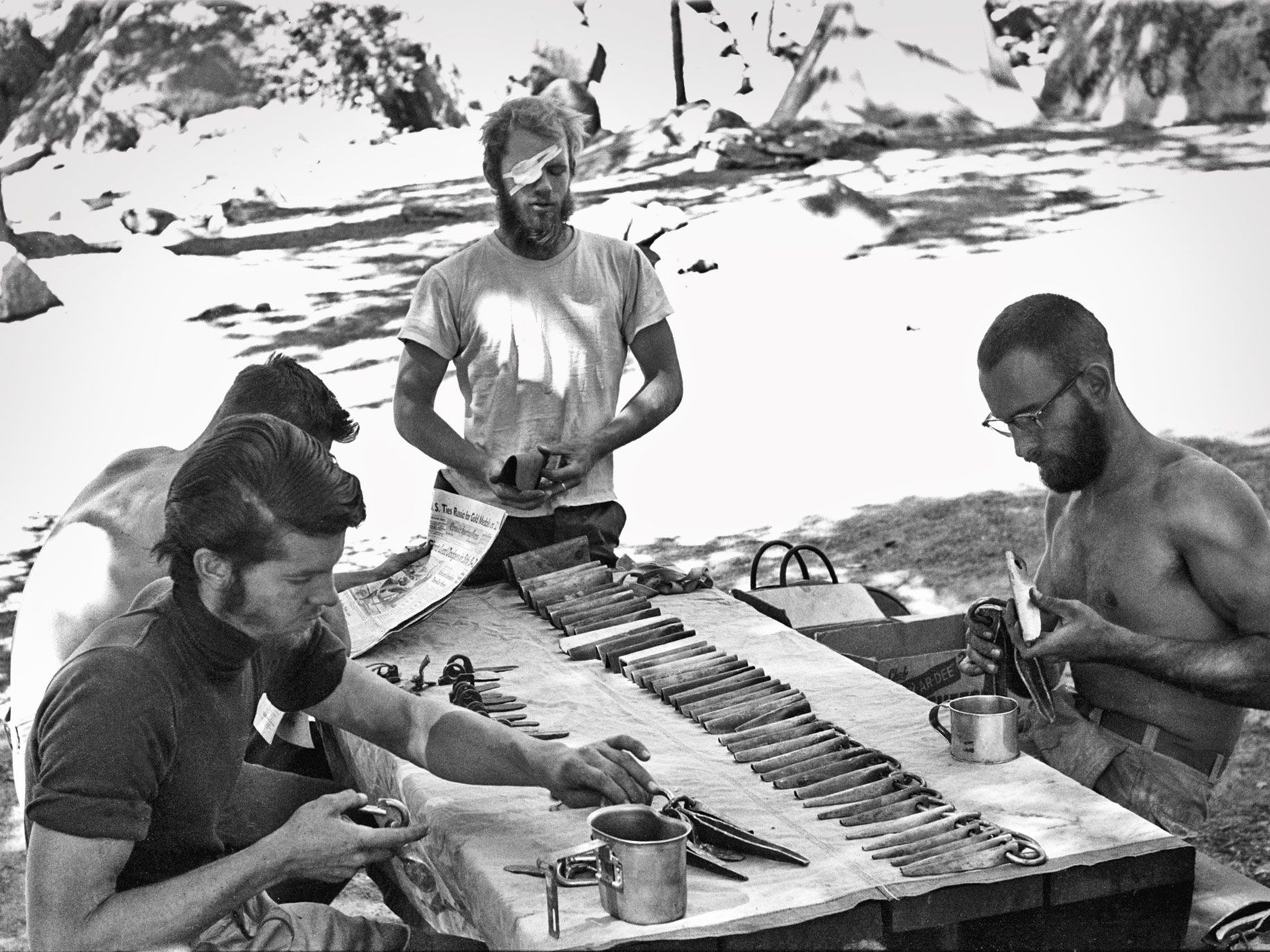 Yosemite climbing pioneers Joe Fitschen, Chuck Pratt and Robbins sorting gear for a 1960 climb of the Nose of El Capitan.