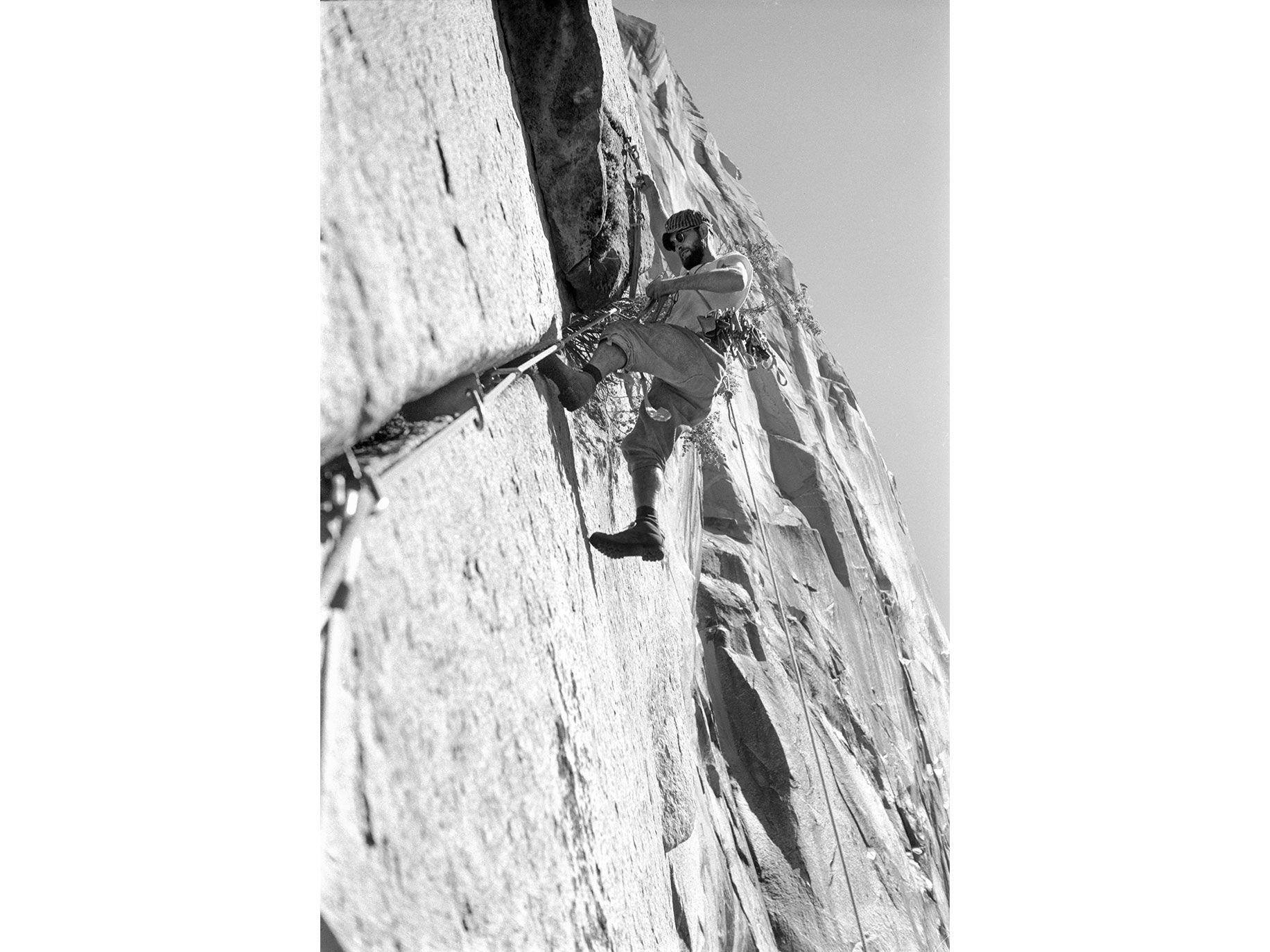 "Robbins ""aid"" climbing, by hanging from pitons driven into cracks, during the ascent of Salathe Wall of El Capitan in 1961."
