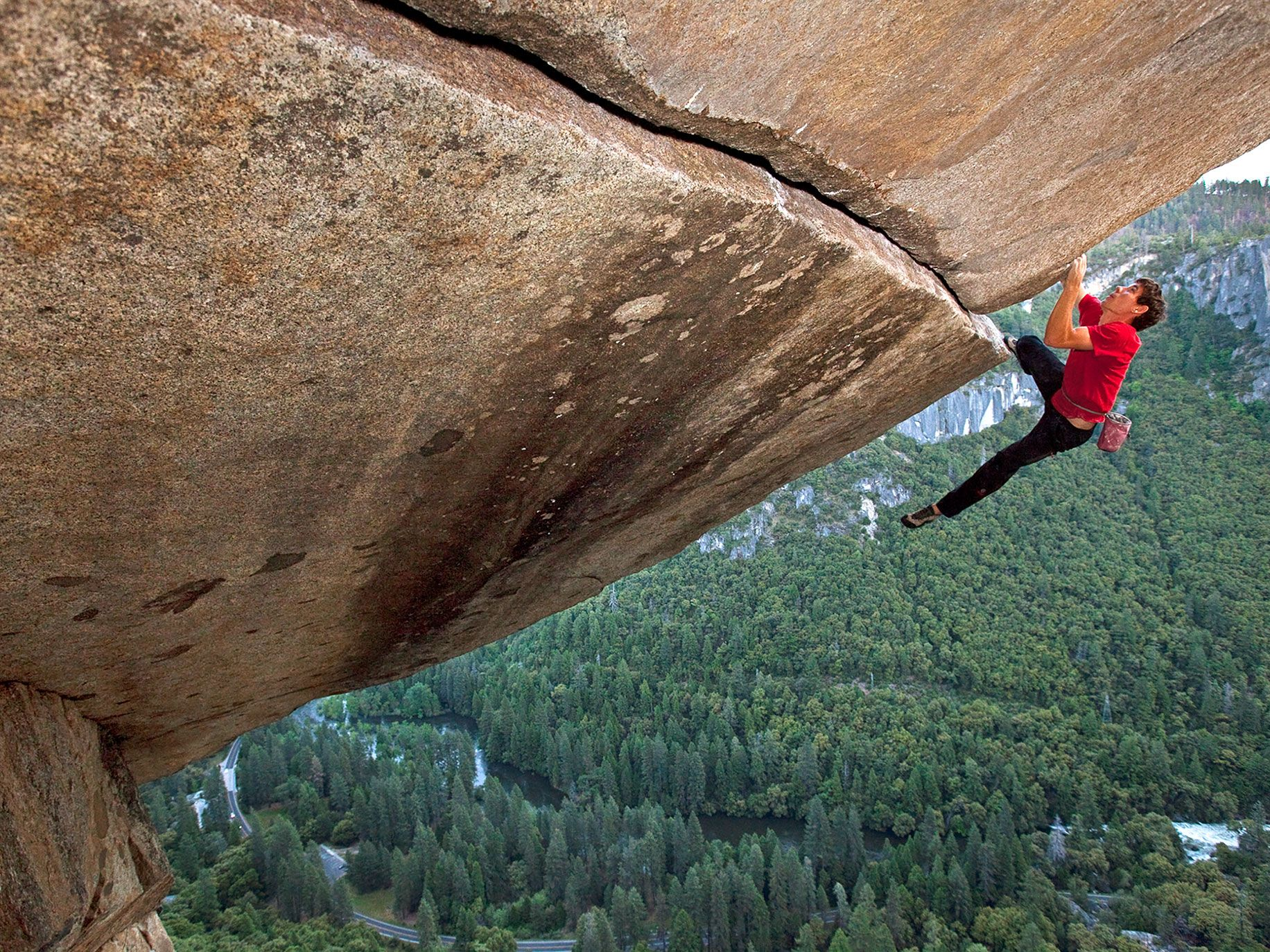 Alex Honnold making a ropeless ascent of the famous Separate Reality, a difficult overhanging formation 500 feet above the floor of the Yosemite Valley.