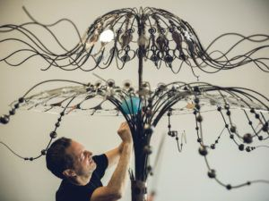 """Artist Richard Wilks in his studio at Los Angeles art colony The Brewery with his latest steel sculpture for the Burning Man festival, """"Queen Jellie."""""""