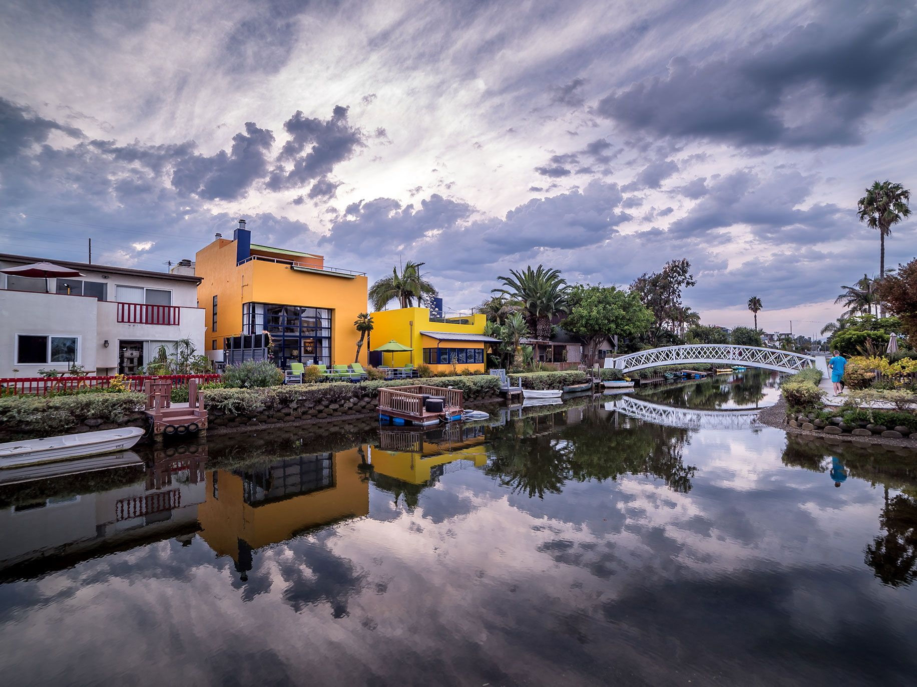 Ramelli recommends that If you get a chance to visit Venice Canals in Los Angeles, go there on a cloudy day to photograph the amazing reflection you get from the still water.