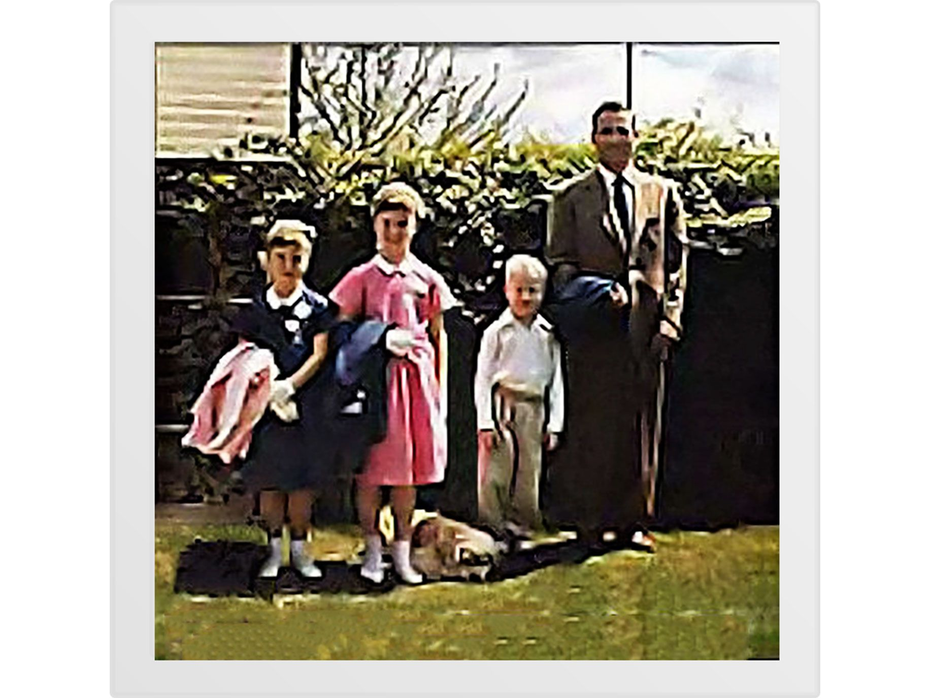 Cassady, dressed in a suit for Easter, poses in the backyard in the 1950s with his children (from left) Jami, Cathy and John.
