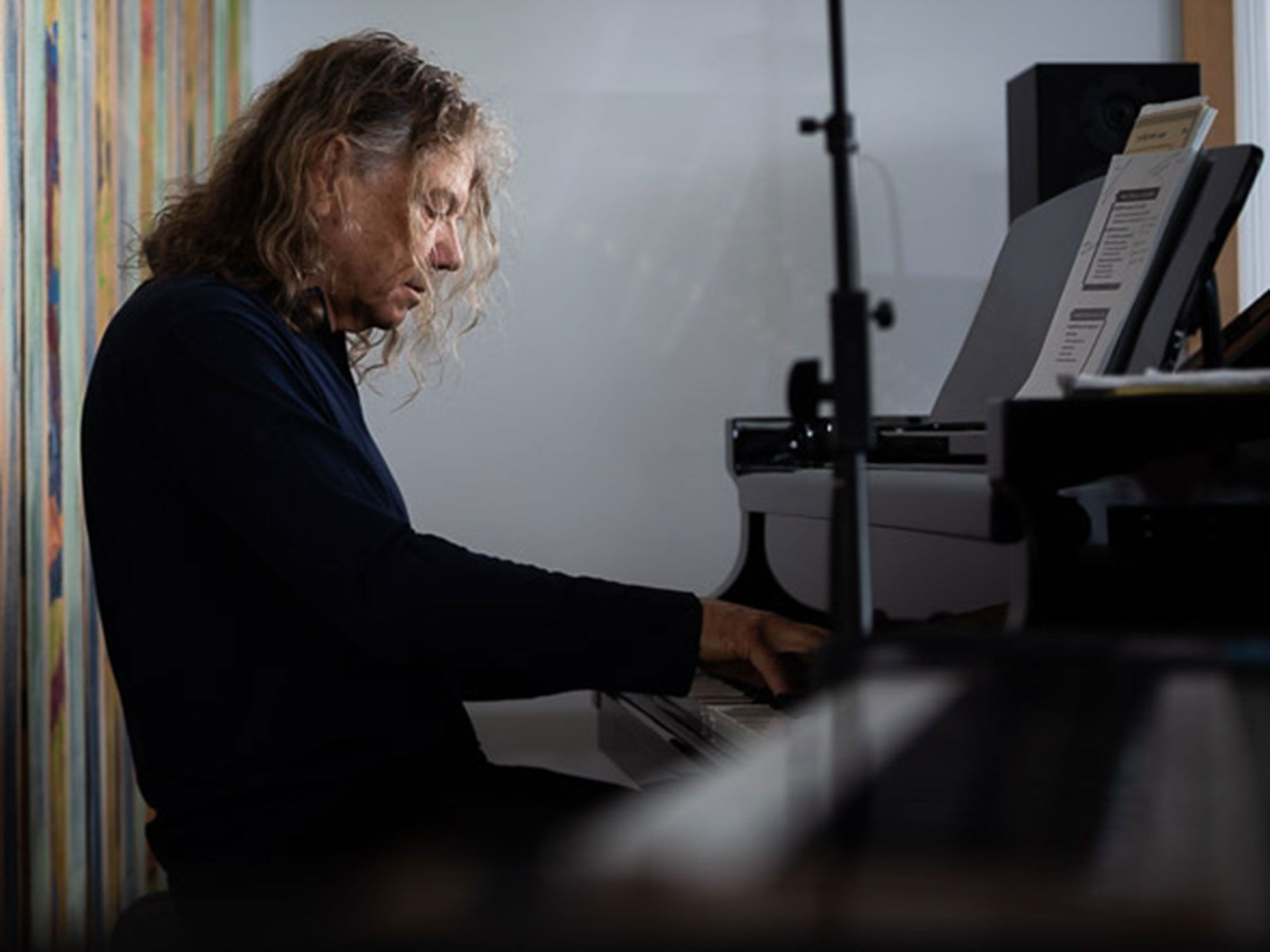 Jerry Harrison plays piano at his home in Marin County.