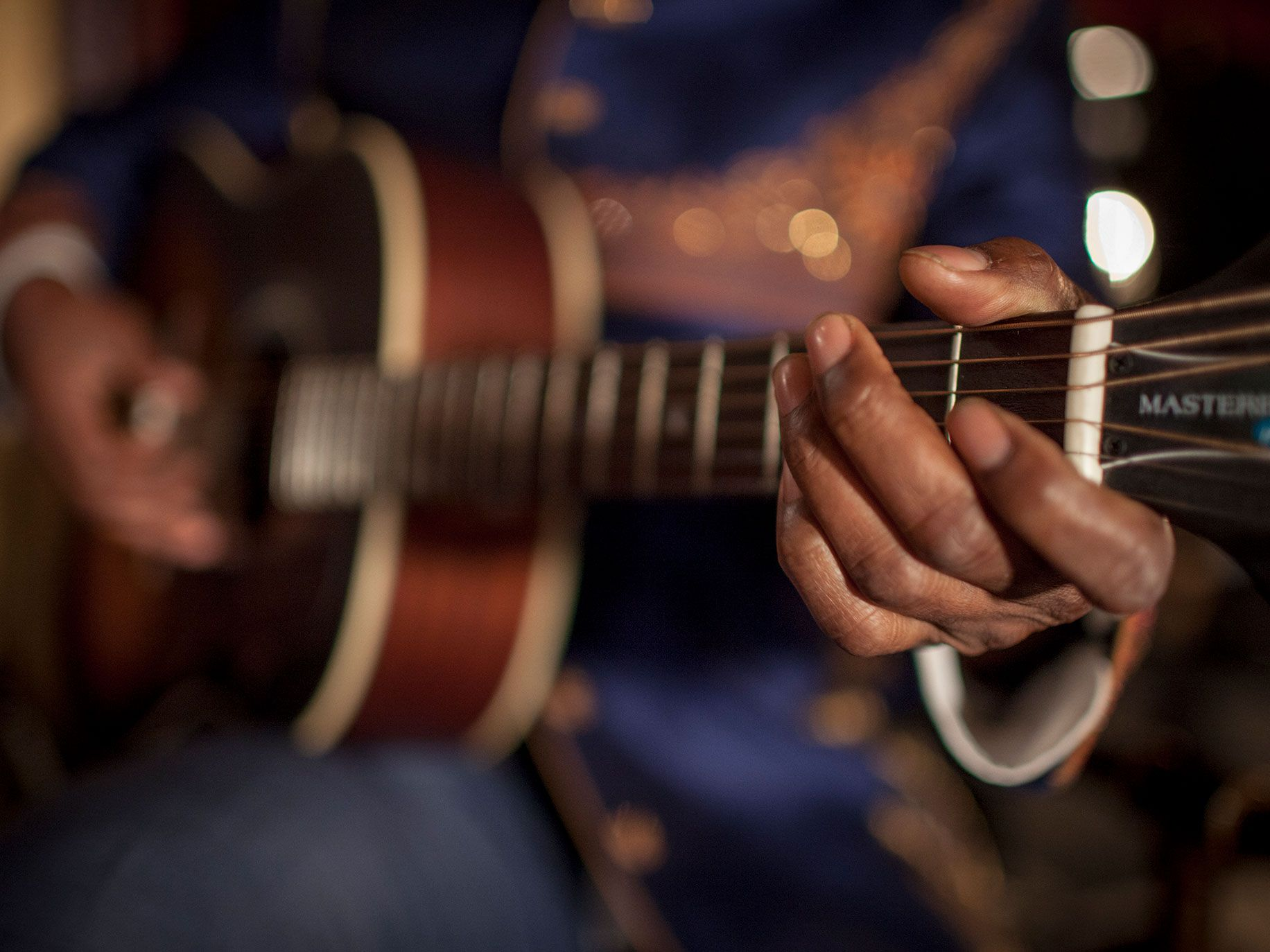This photo shows Fantastic Negrito playing his guitar at The Fillmore in San Francisco.
