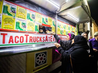 Muslim customers line up and chow down at a Taco Trucks at Every Mosque event at the Islamic Society of Orange County in Garden Grove, illustrating the increasing ethnic diversity and mix in Orange County.