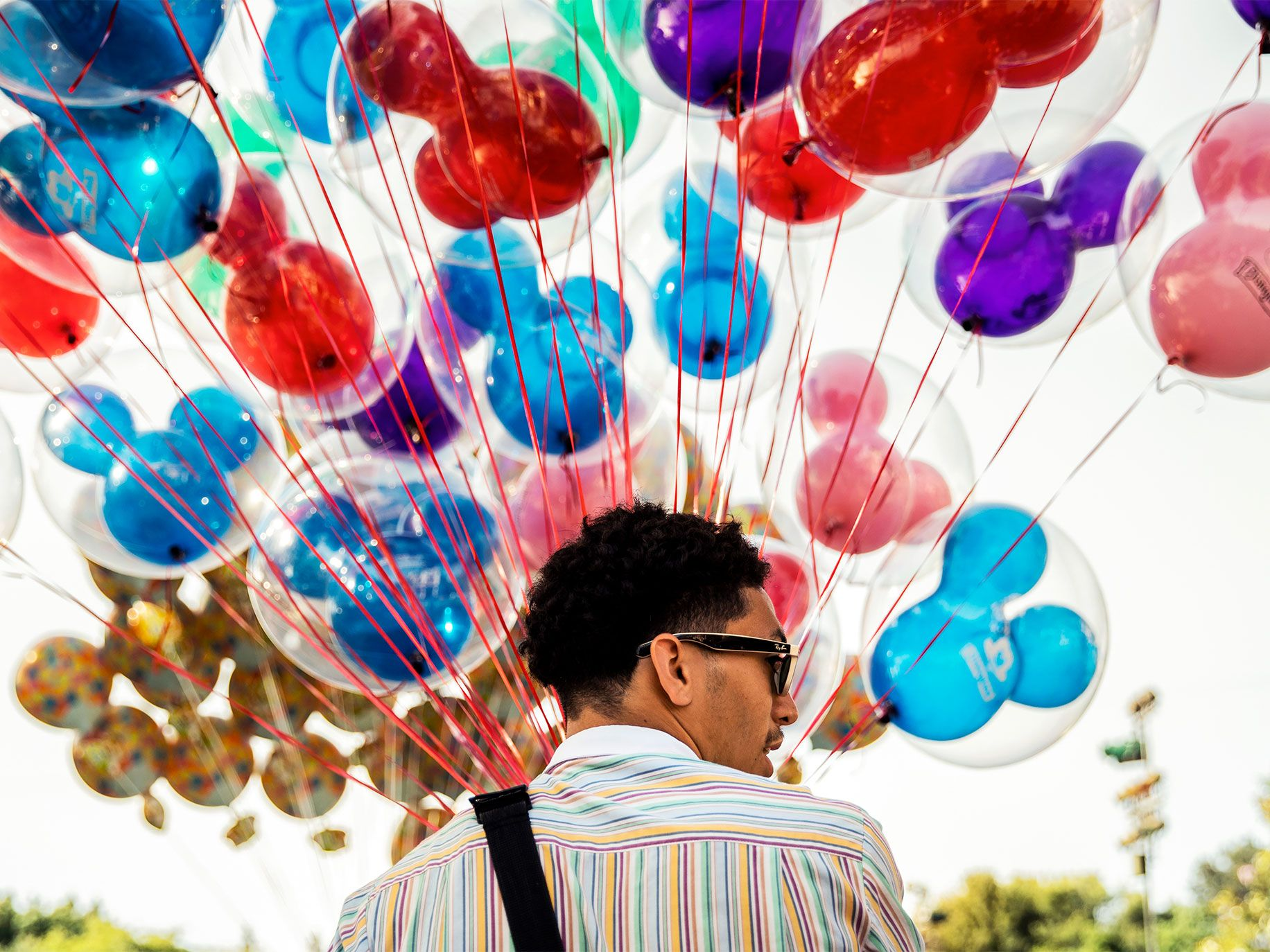 A balloon seller at Disneyland. Anaheim voters will decide in November whether to pass a living-wage ordinance for businesses, like Disney, that take subsidies from the city.