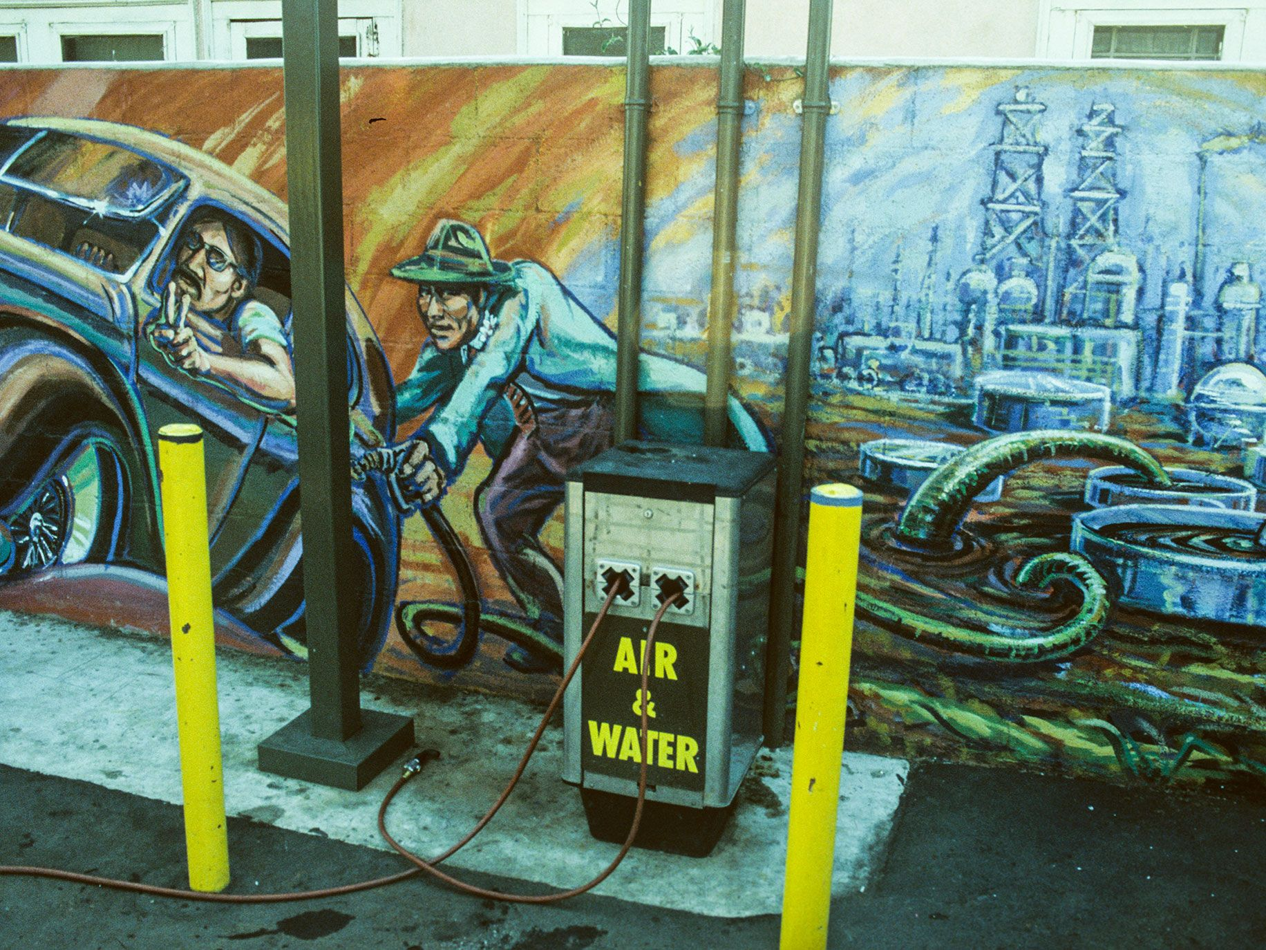 "Detail from ""Filling Up on Ancient Energies"" by East Los Streetscapers, 1980."