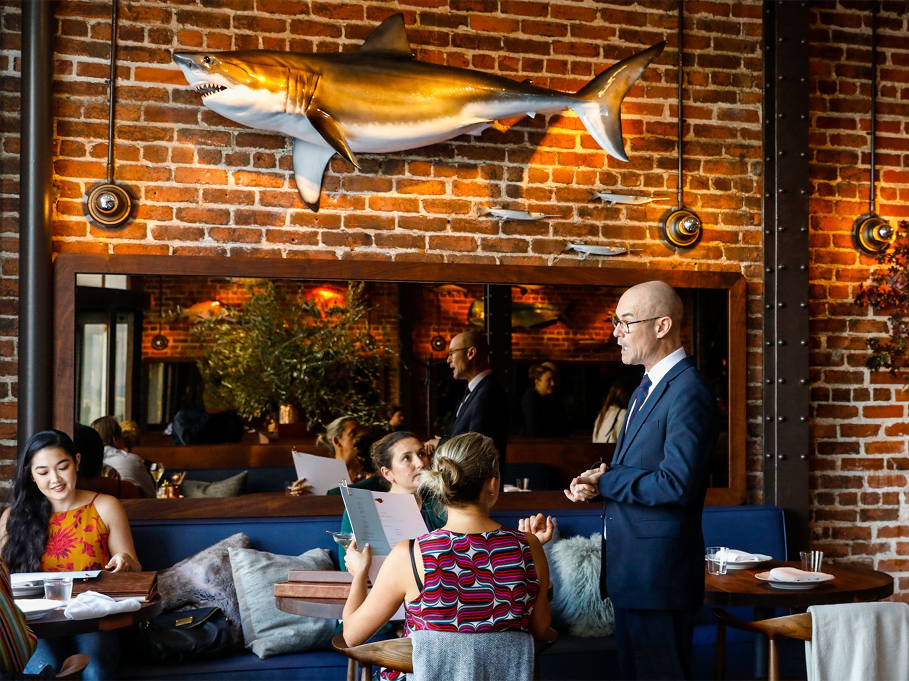 Angler's decor uses the original brick walls in the restaurant's interior that overlooks the Bay Bridge. Fish hung on the walls enhance the rustic ambiance.