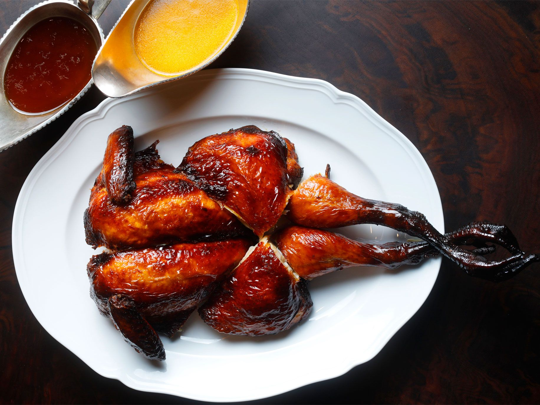Skenes's honey-coated whole chicken resembles a lacquered Peking duck.