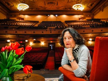Sydney Goldstein on stage at her beloved Nourse Theater, which she transformed from a nearly derelict auditorium to the home of City Arts & Lectures in 2013.