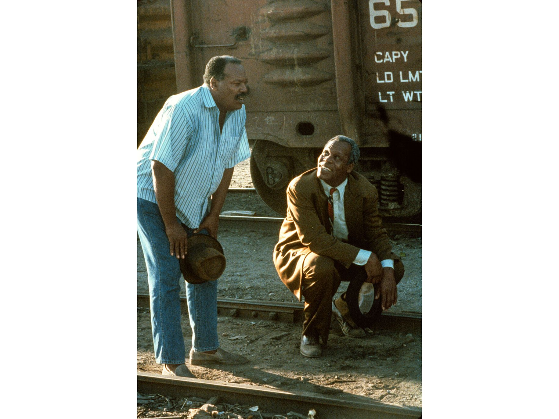 "As a Deep South trickster, Danny Glover (right) develops a marvelous yet destructive rapport with Paul Butler, as a South L.A. retiree, in ""To Sleep with Anger."""