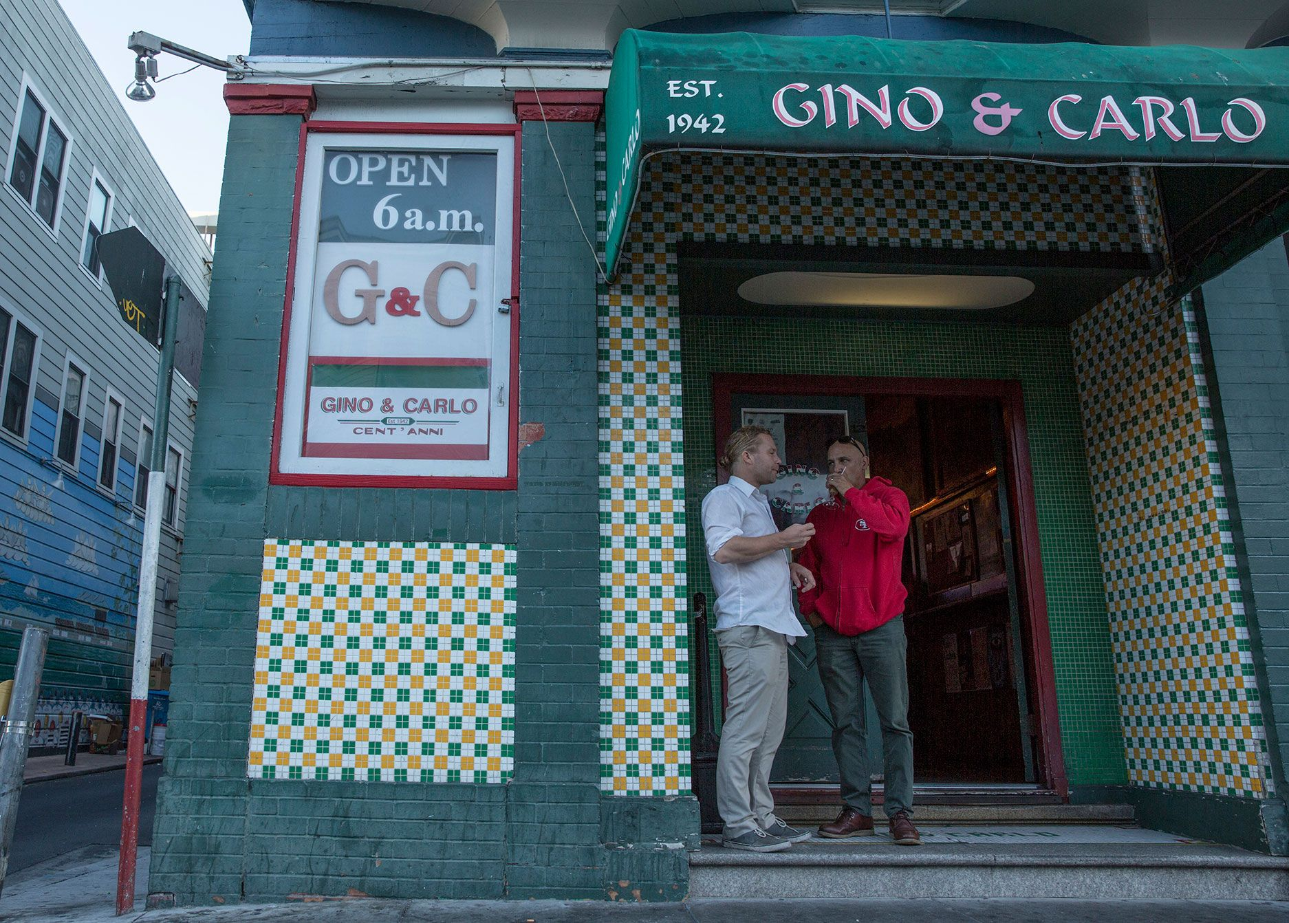 Gino & Carlo's at 6 a.m. is full with locals and regulars sitting around reading the paper, drinking coffee — and beers or shots.