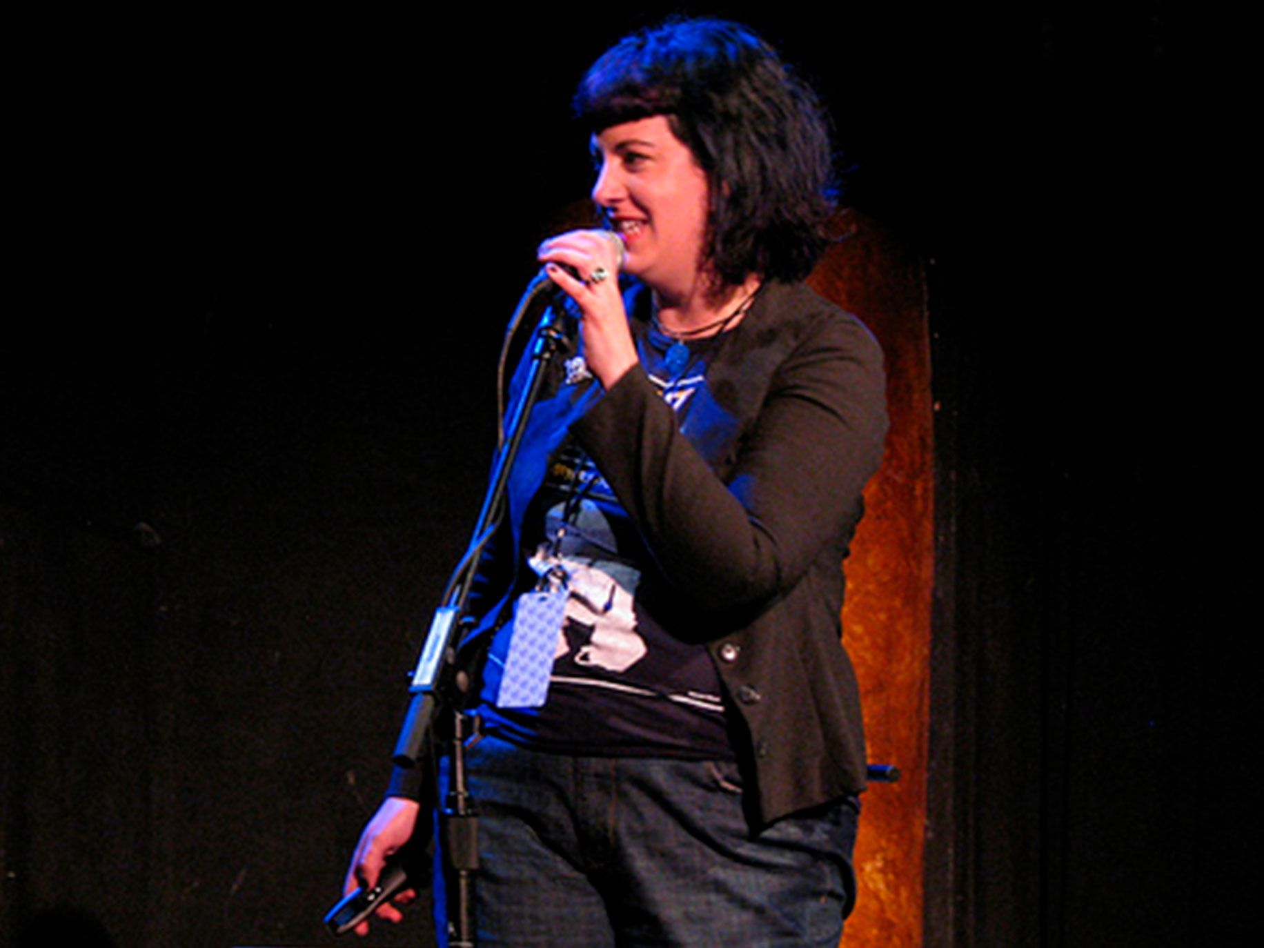 Bonnie Burton performs comedy on stage at w00tstock San Francisco in 2010.