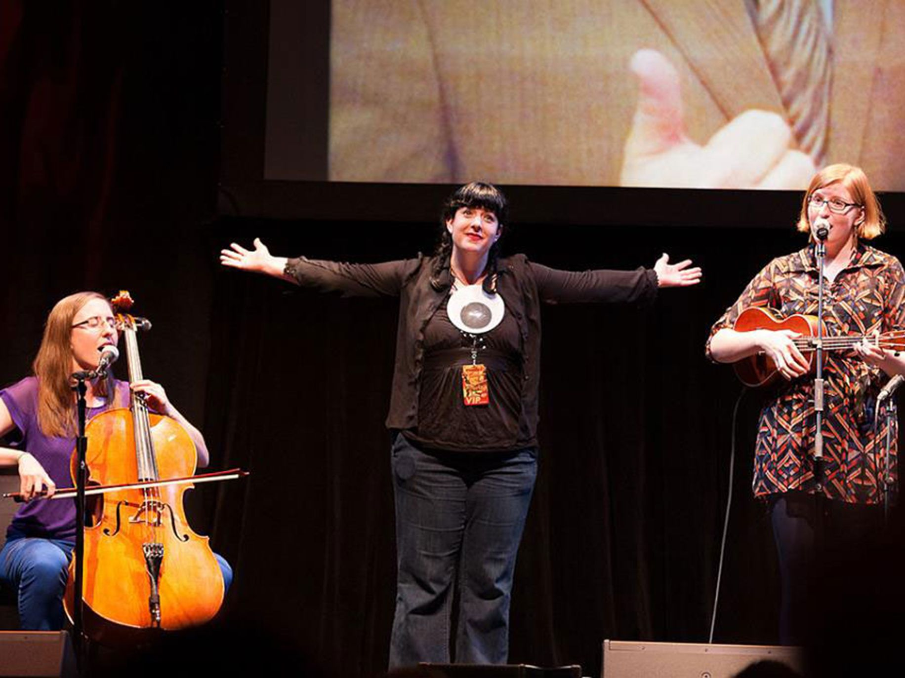 Bonnie Burton on stage with The Doubleclicks band at w00tstock San Diego.