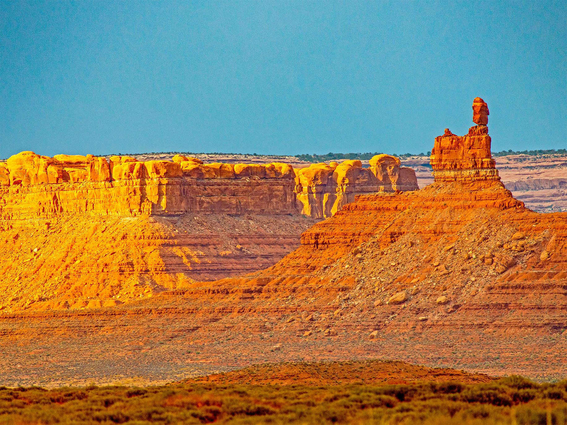A sandstone tower in the Valley of the Gods, with Cedar Mesa in the background. President Trump's executive order removed both areas from the Bears Ears National Monument.