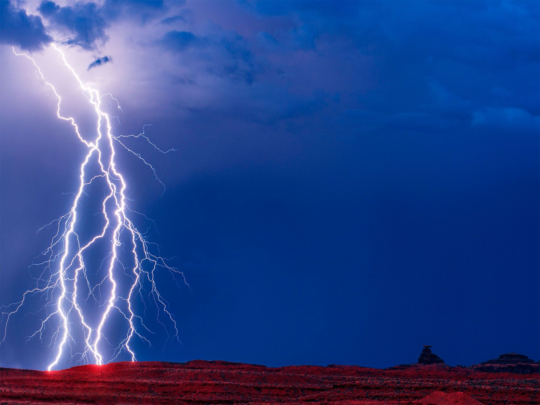Bolts of lightning near Mexican Hat Rock, which marked the southern border of the original Bears Ears National Monument.