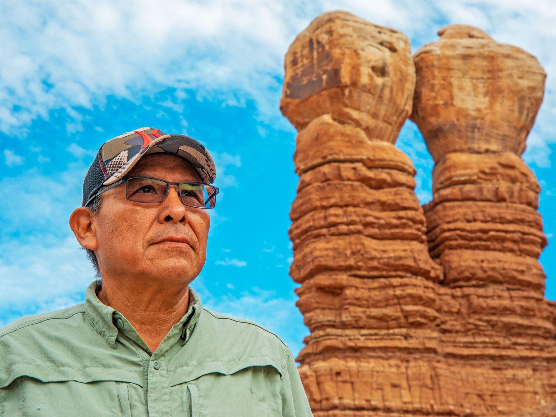 Navajo leader Mark Maryboy at Twin Rocks, a natural formation in Bluff, Utah.