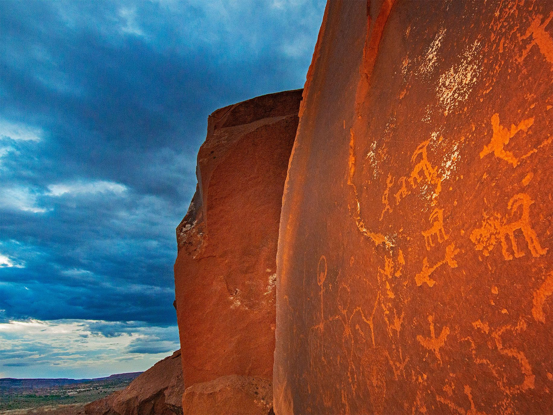 Ancient Native American petroglyphs carved into a sandstone boulder beneath Comb Ridge, which is still protected by Bears Ears National Monument. Countless other archaeological sites now fall outside the monument's new — and contested — boundaries.