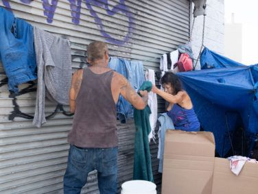 Jeff Chavez and his girlfriend have made their home in a makeshift tent on Skid Row for the past five years. Every two weeks, the couple decamp to make way for street cleaning.