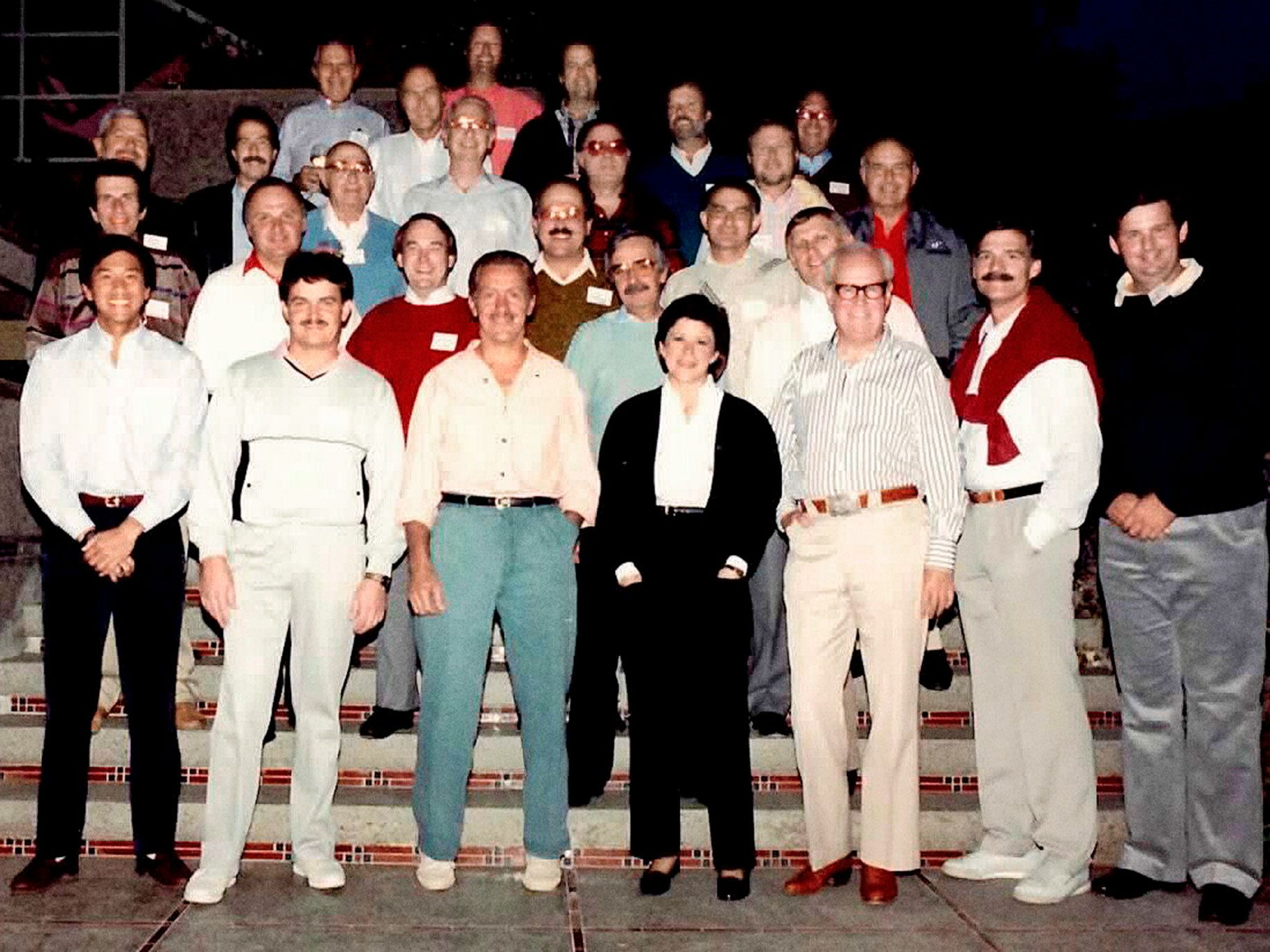 MJ Elmore, front row center, was the only woman in a group that included 26 men at the IVP retreat in 1987. As a partner at the venture firm, she led its investment in Sequent Computers and numerous other startups.