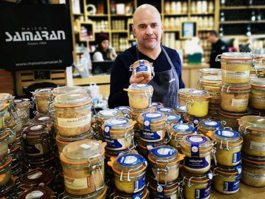 Christophe Samaran holds a jar of foie gras at the boutique that bears his family's name. Samaran is one of the Gascony region's most celebrated producers and sellers of foie gras.