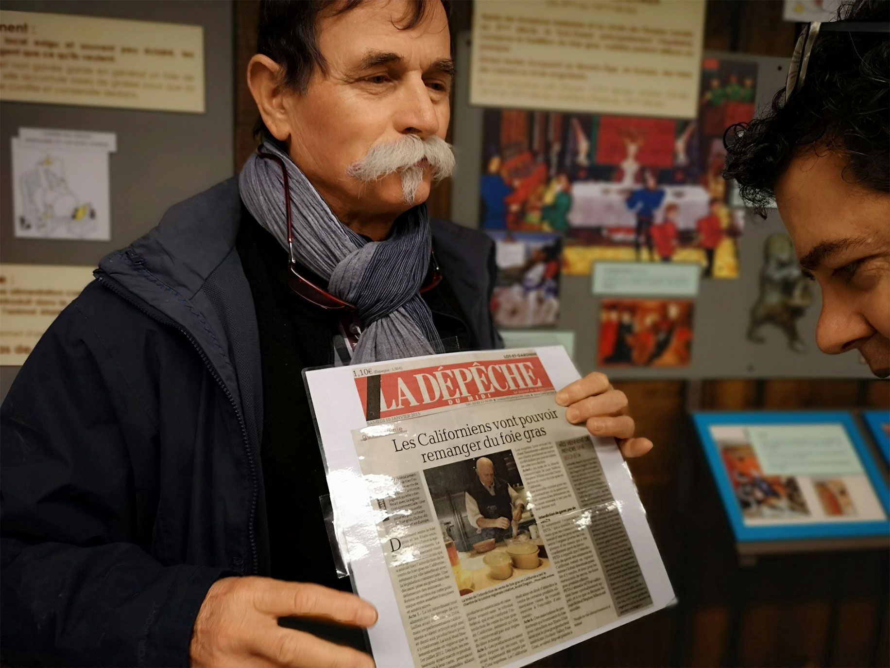 Museum of Foie Gras's owner Yves Boissiere holds a local newspaper from January 2015 celebrating a US court's decision to overturn California's foie gras ban. The Museum is located on the farm where Boissiere raises ducks and produces foie gras in Souleilles.