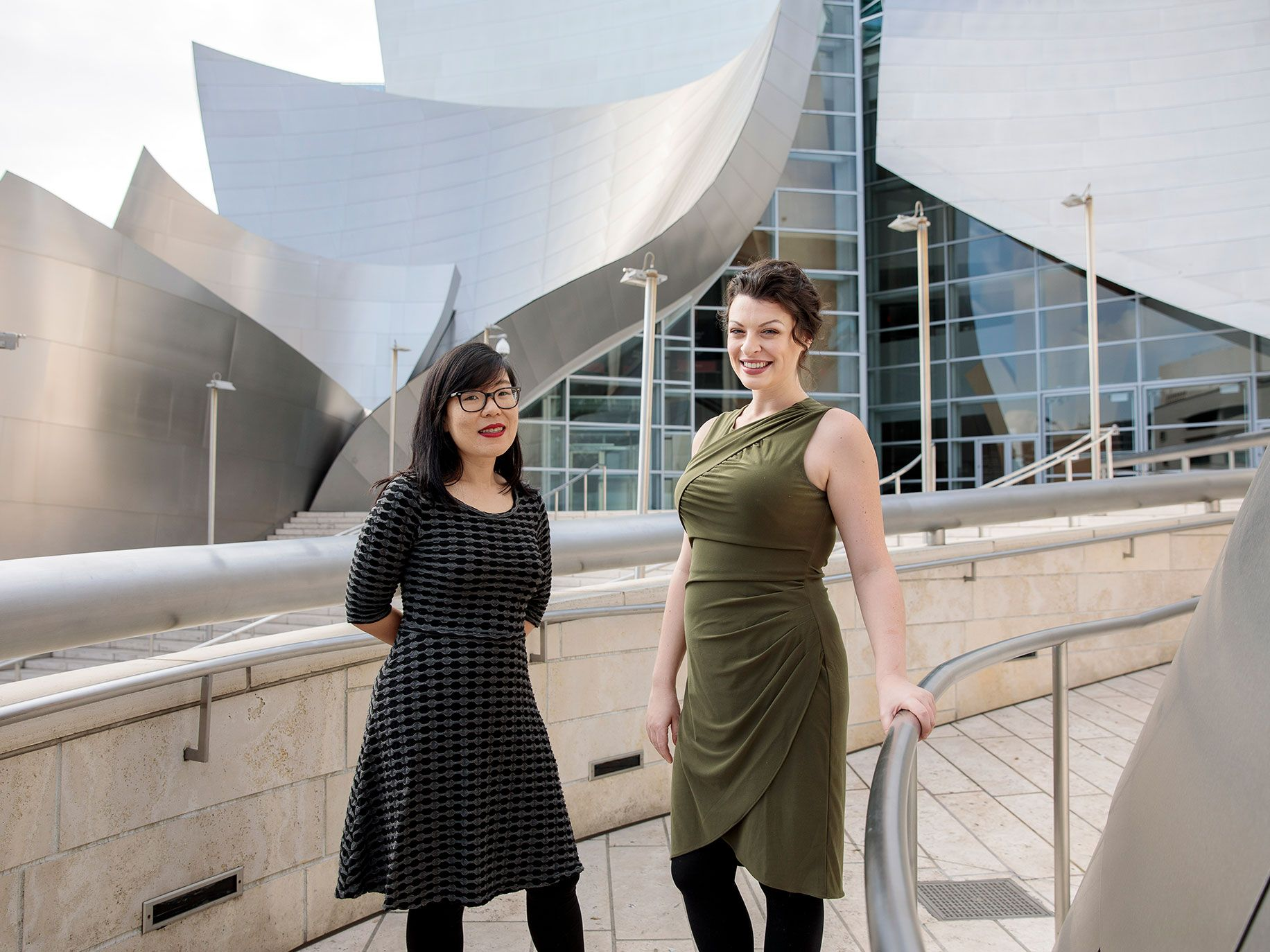 L.A.-based composers Carolyn Chen, left, and Julia Adolphe outside the Walt Disney Concert Hall. Both of their works were performed by the Los Angeles Philharmonic as part of its 100th-anniversary celebration.