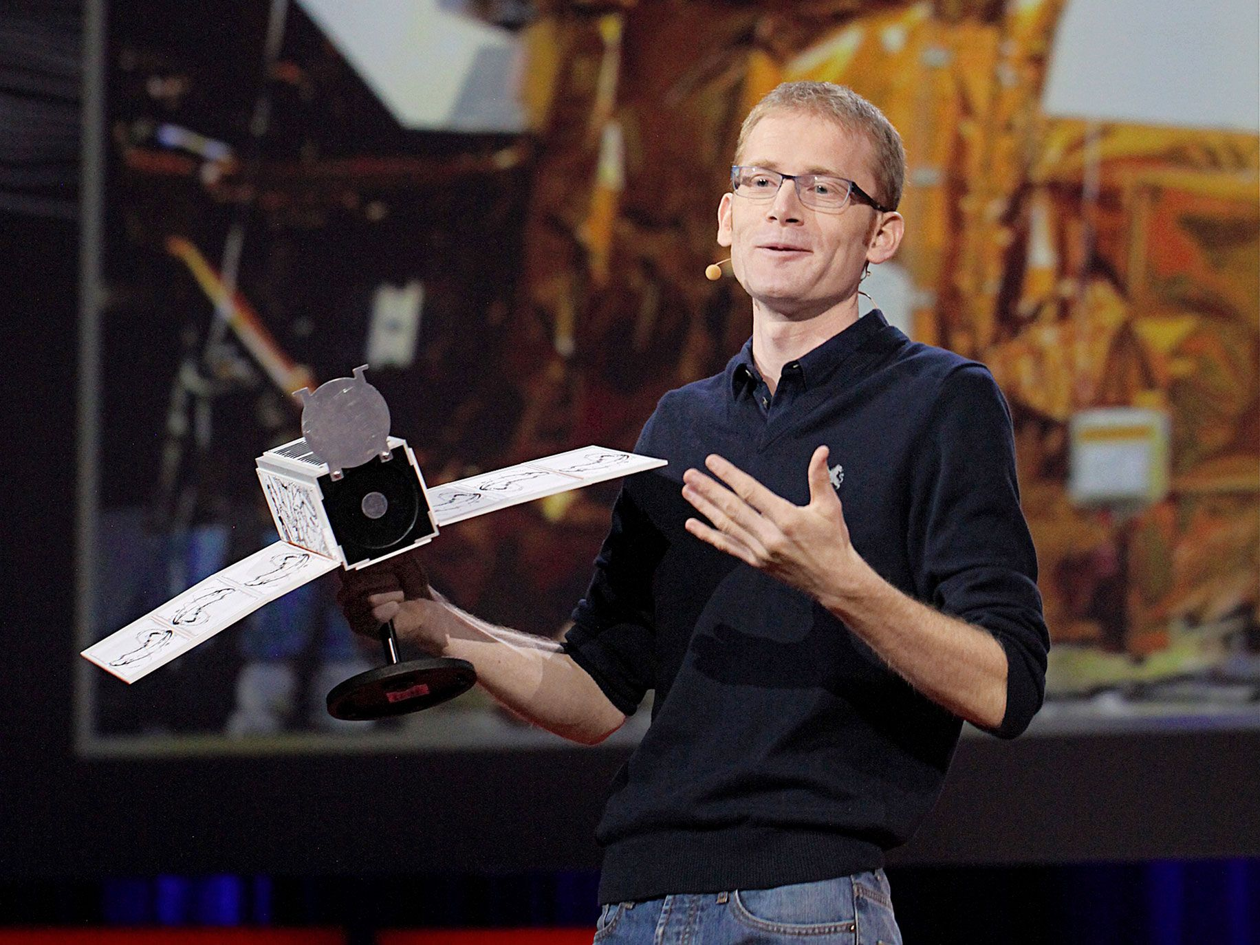 Will Marshall, CEO of Planet, holds one of his company's Dove satellites. Each weighs approximately 11 pounds and measures, unfolded, about 4 inches by 4 inches by 12 inches.